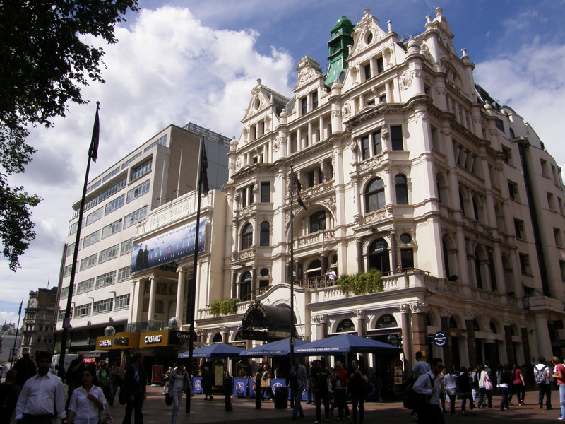 The 19th-century Queen's House (right) and the Empire Theatre (left) on the north side of Leicester Square