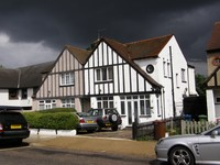 Storm clouds and Mock Tudor houses