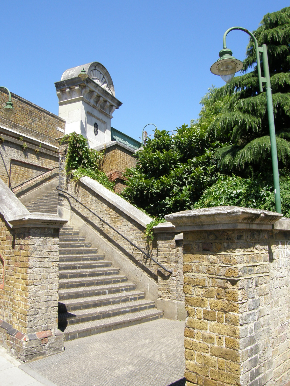 Steps up to the walkway over Fulham Railway Bridge