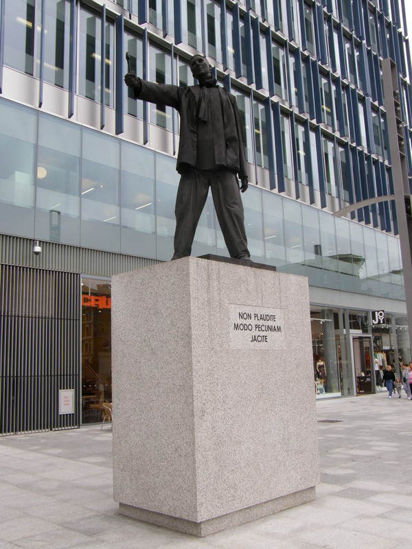 The statue outside the Blue Fin Building: 'Don't applaud, just throw money'