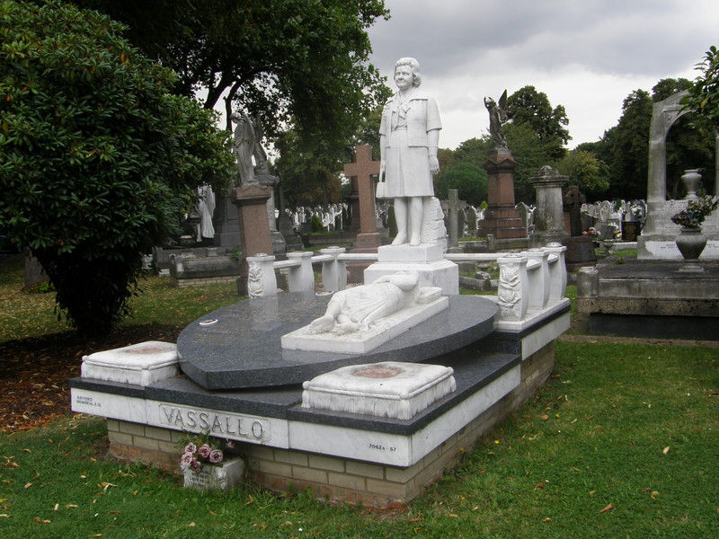A memorial to a lady with a handbag in East London Cemetery